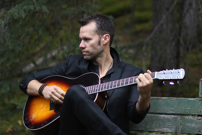 Chad Brownlee playing guitar