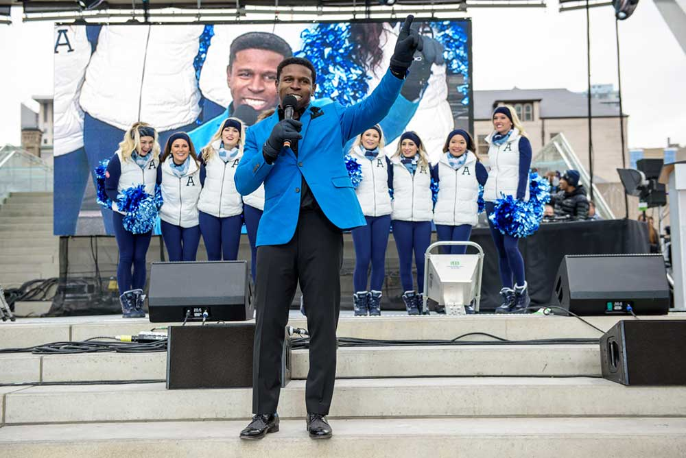 "Michael ""Pinball"" Clemons in a blue suit"