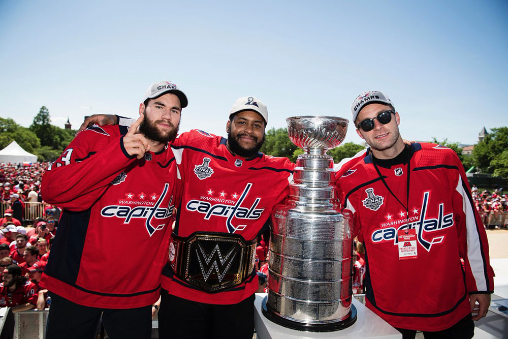 three players posing with the Stanley cup