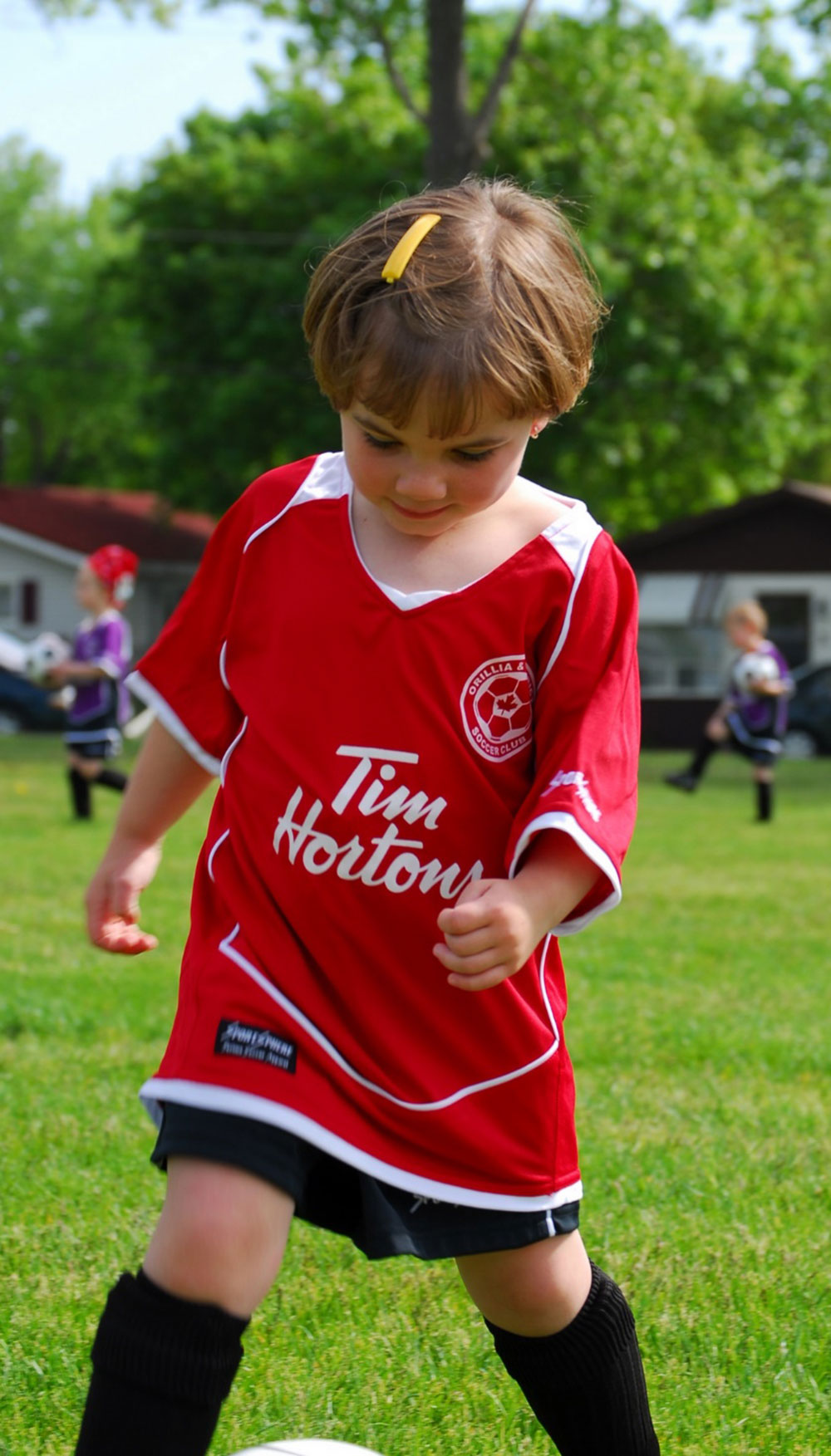 young child in red soccer uniform